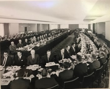 """NCR executives sit for lunch with Coach Donoher in the """"Horseshoe Room"""" at the corporate headquarters."""
