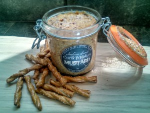 A jar of Dayton Comestibles Corn Whiskey Mustard by Dayton Comestibles