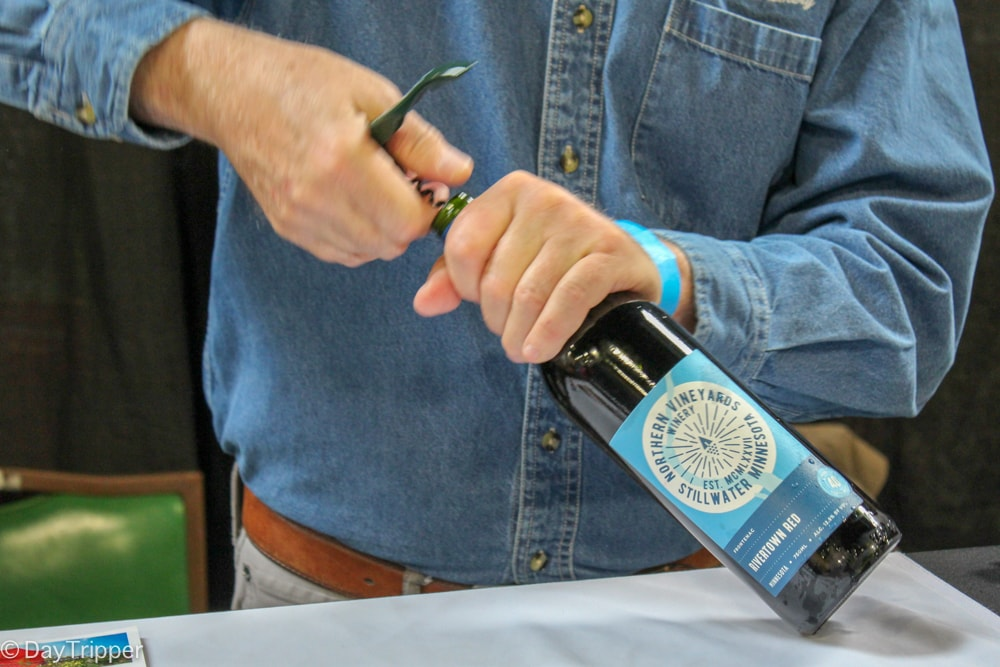 Opening another bottle at Clink Wine Festival