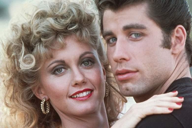 1977 --- John Travolta embraces Olivia Newton-John on set of --- Image by © Alan Pappe/Corbis
