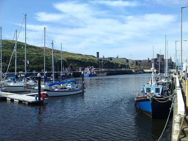 Peel Harbour and castle.  New marina pontoons to left, quay to right.