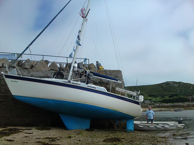 Dried out alongside Tresco Harbour Quay.