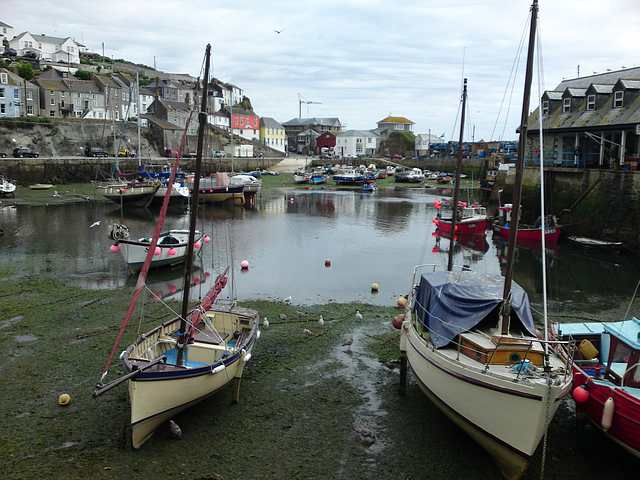 Mevagissey Harbour at low tide.