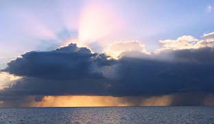 The sunset & storms on our last night there.