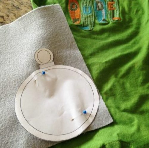 Turn a baby romper into a Tick Tock Croc costume