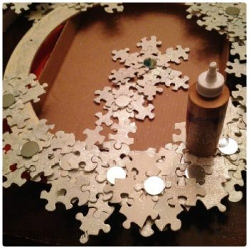 Use puzzle pieces to create a snowflake wreath | DazzleWhileFrazzled.com