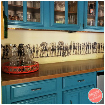 Use a vintage black and white photograph as a wet bar backsplash