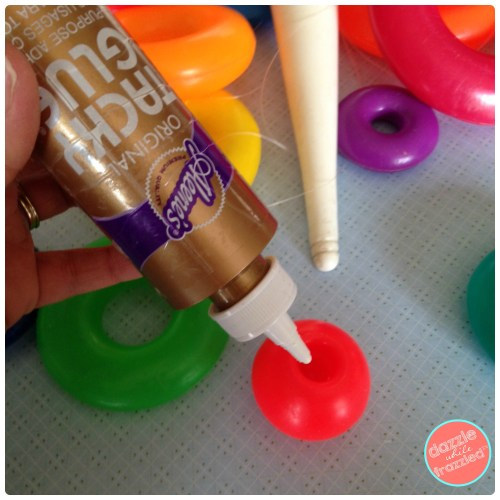 How to use a stacking ring to create a DIY toy mobile | DazzleWhileFrazzled.com