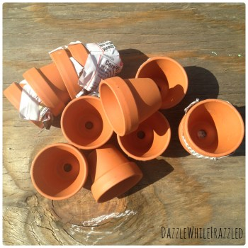Use miniature sized terra cotta flower pots for DIY flower pot wreath for spring decor.