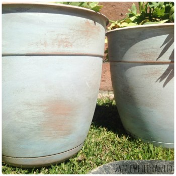 Give plastic flower pots the look of aged clay terra cotta with paint and sanding block.