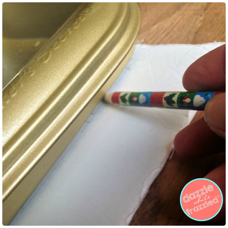 Use foam core board to trace shape of repurposed baking pan for DIY wall frame art.