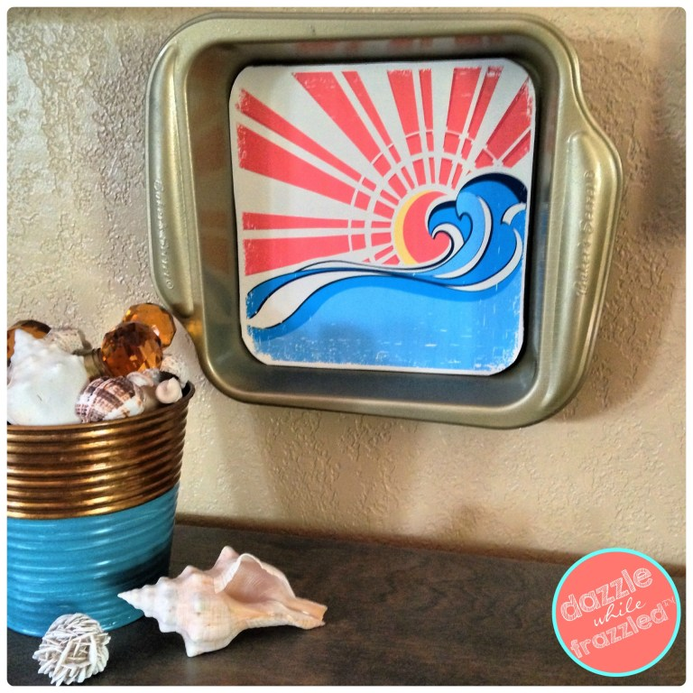 Hang a repurposed baking pan on a wall as a DIY wall frame art.