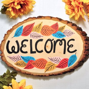 Wood slice hand-painted welcome sign for autumn home.