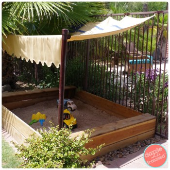Give the kids a place to play outside with DIY backyard sandbox made with $2 redwood fence posts.