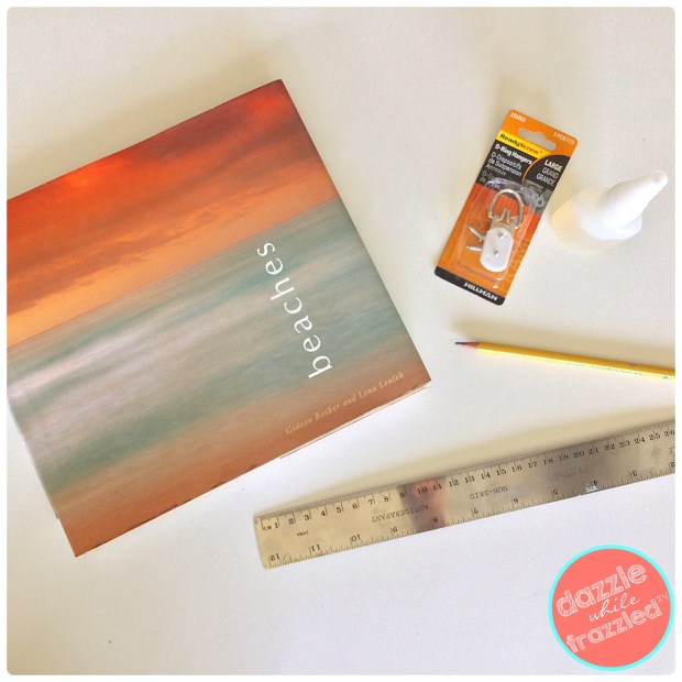 How to turn a hardcover coffee table photo book into a wall photo frame   DazzleWhileFrazzled.com