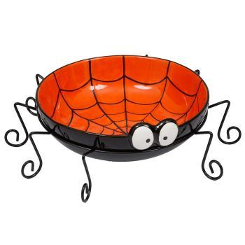 Serve Halloween treats from ceramic spiderweb bowl you can buy on Amazon.