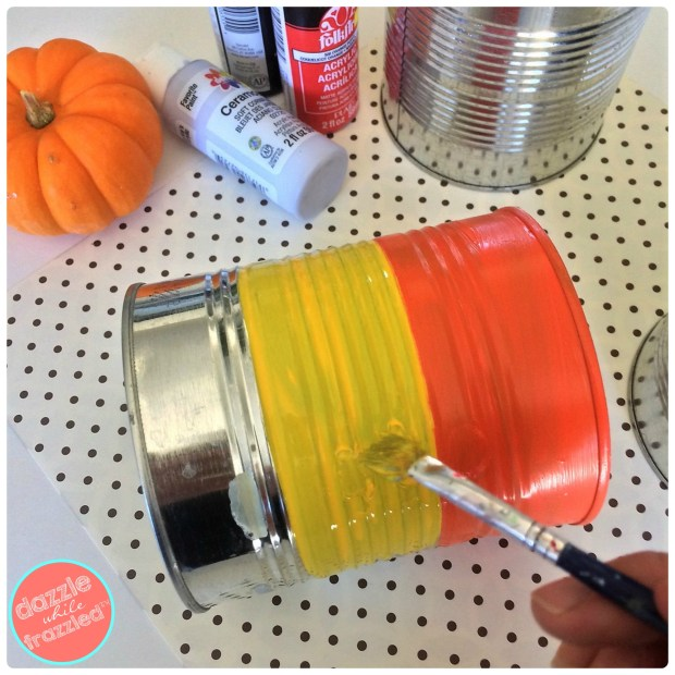 Use large tin cans to make Halloween treat candy holders | DazzleWhileFrazzled.com