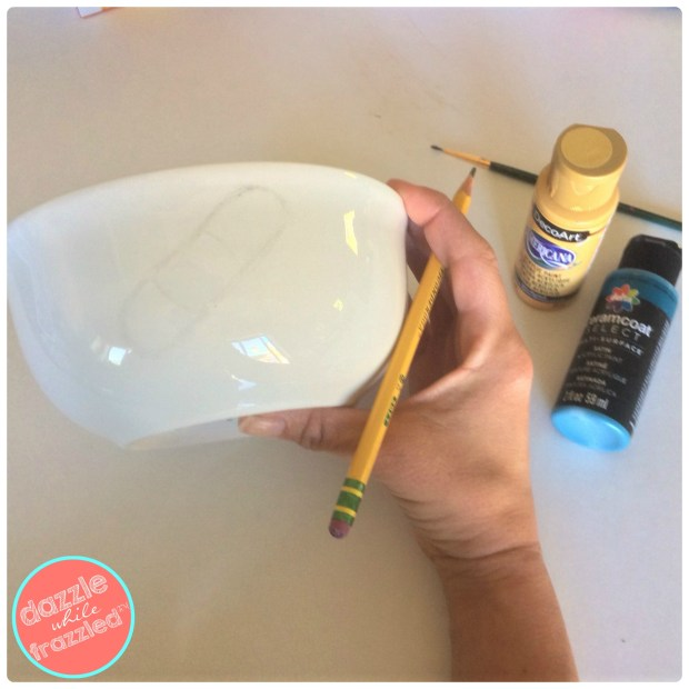 Sketch a design with pencil onto a porcelain white soup bowl to make a DIY chicken soup bowl as part of a DIY get well soon gift basket