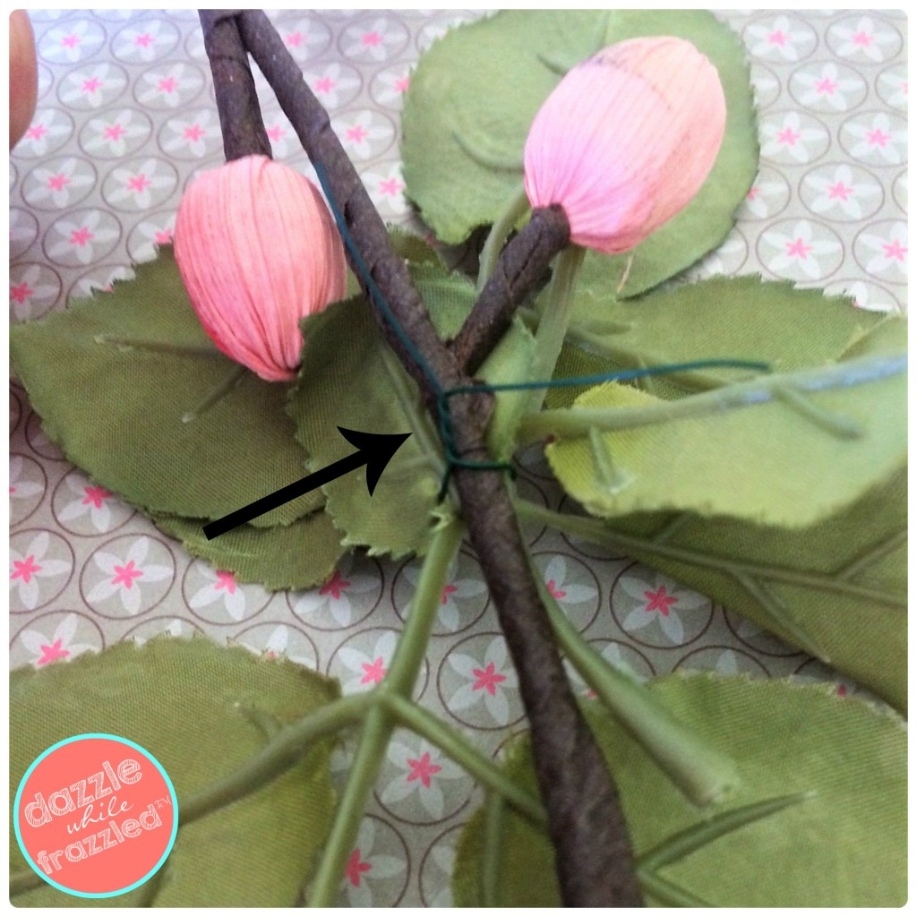 Use faux flower stems to make an easy heart wreath with artificial flowers and floral wire
