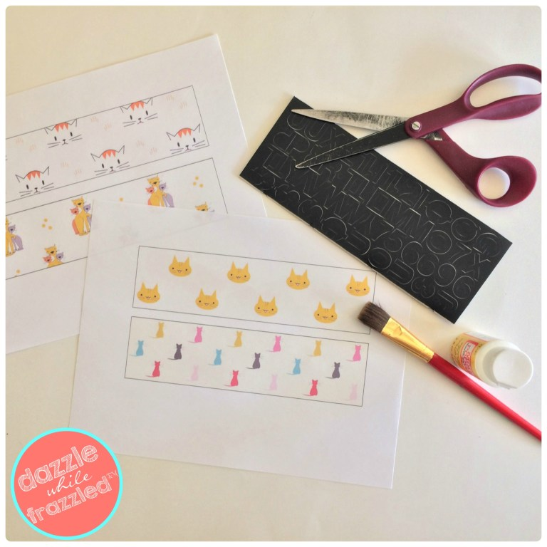 Make a personalized cat name plate for litter box using scrapbook paper and letter stickers.