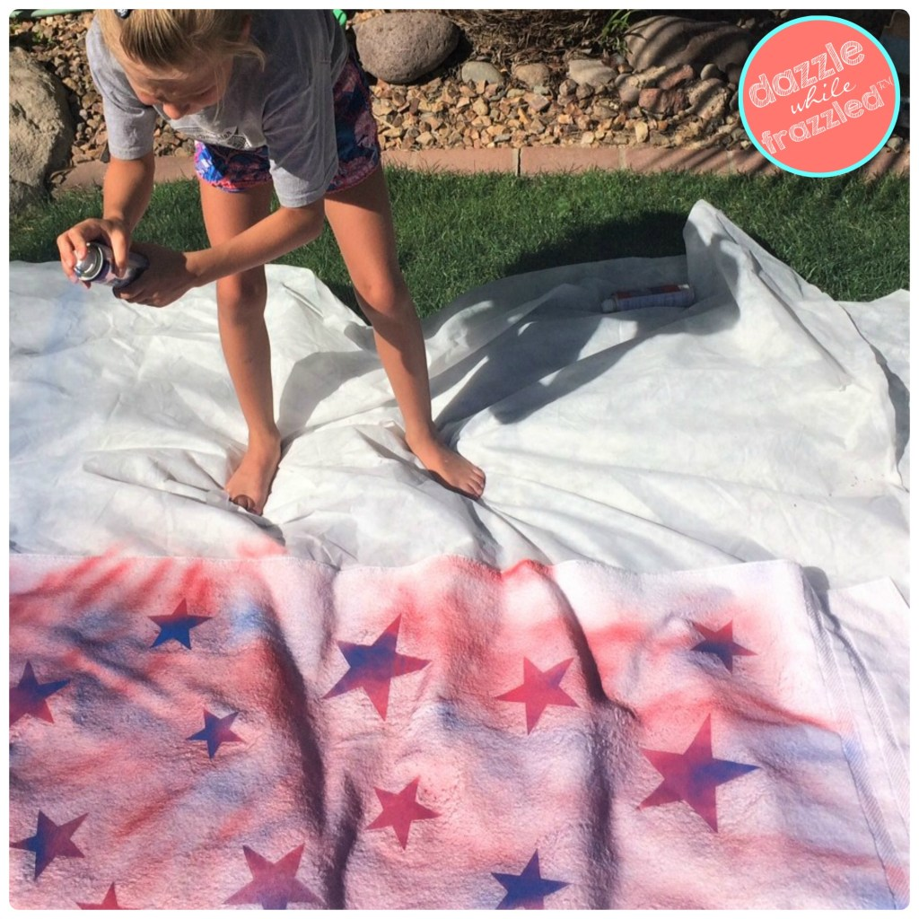 Fun kids summer craft to fabric spray paint white beach towels.
