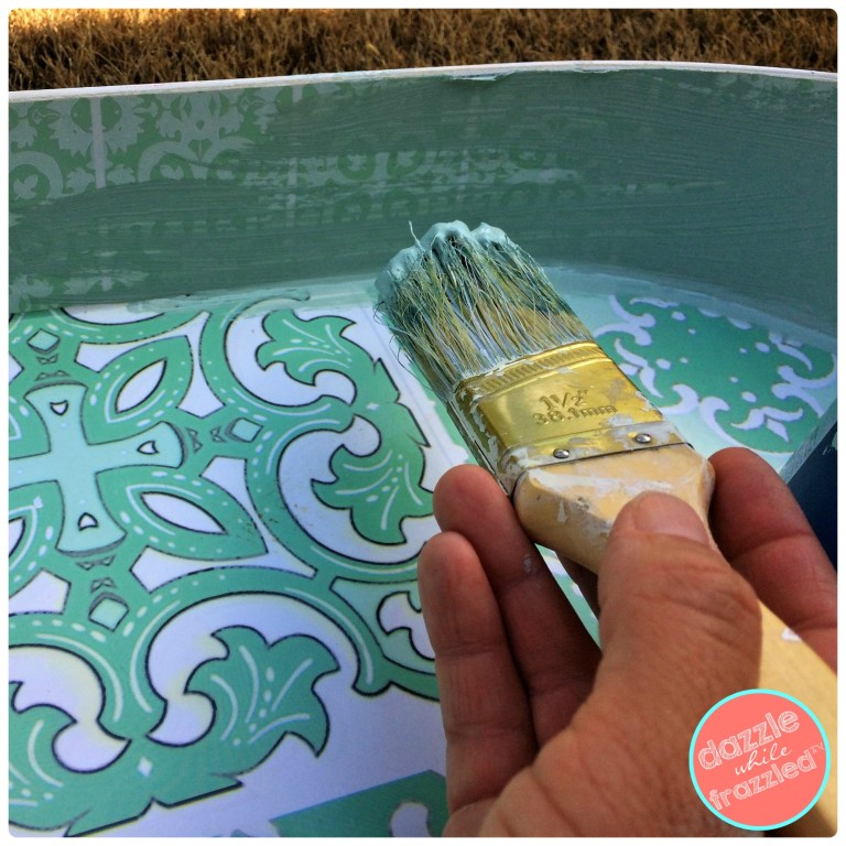 Paint the sides of a metal tray to make a DIY magnet board.