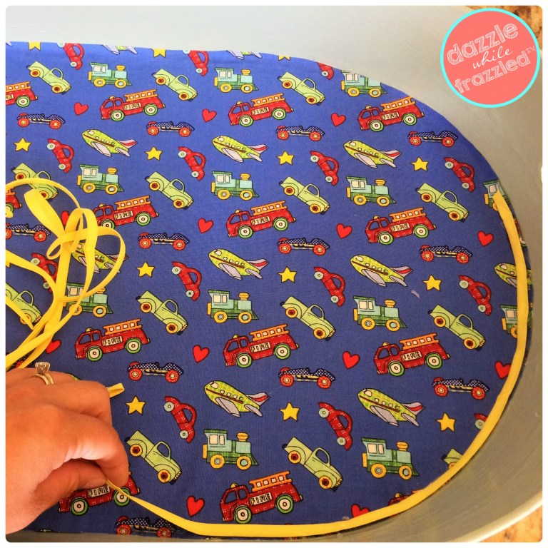 Use trim or ribbon to cover up raw edge of fabric covered magnet board for a kids bedroom wall.