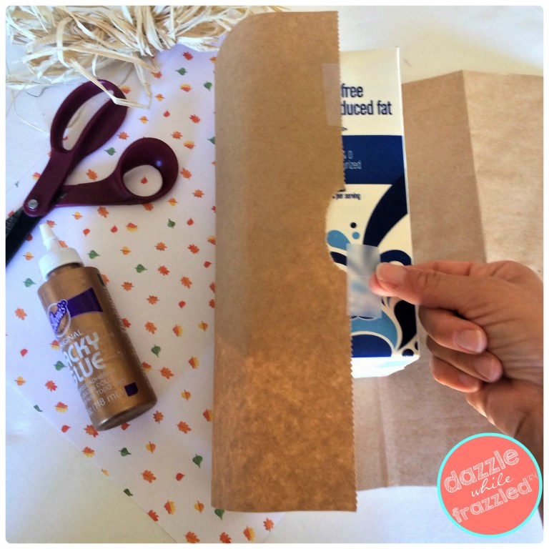 Wrap cardboard milk carton with brown butcher paper or brown grocery bag for DIY autumn leaf vase.