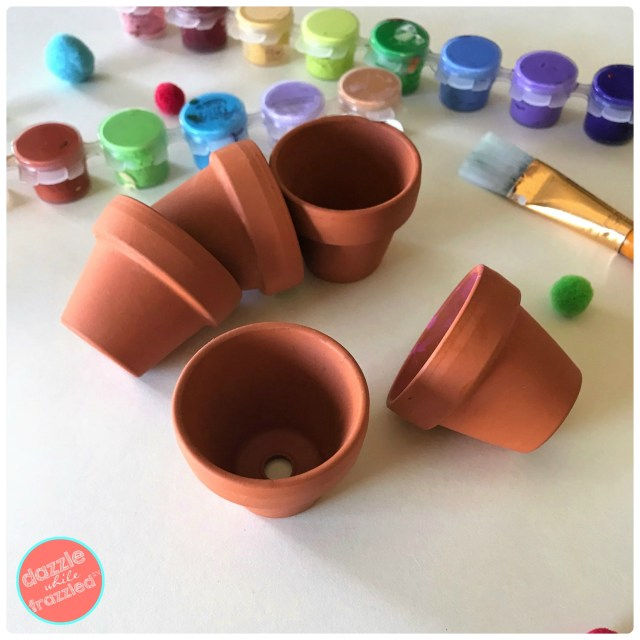 Paint mini clay flower pots with acrylic paints to make DIY Christmas tree ornaments and gift tags for presents.