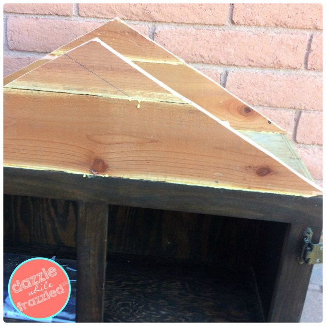 Make a pitched a-frame roof from redwood slats on top of repurposed kitchen cabinet for DIY Little Free Library.