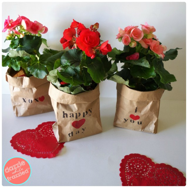 DIY stenciled brown paper bags for holding and gifting small potted plants. Easy Valentine's Day, hostess, teacher gifts.