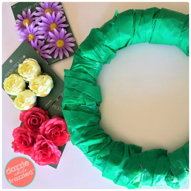 Use faux flower head blossoms and styrofoam wreath for easy pretty springtime wreath.