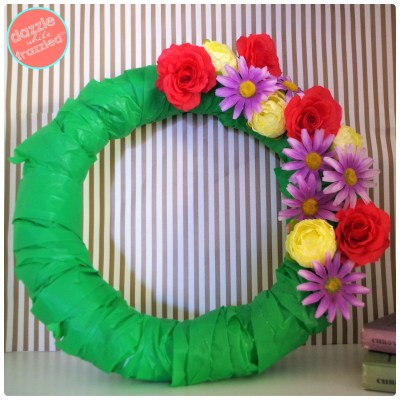 Make a pretty fake flower head spring blossoms wreath for springtime home decor.