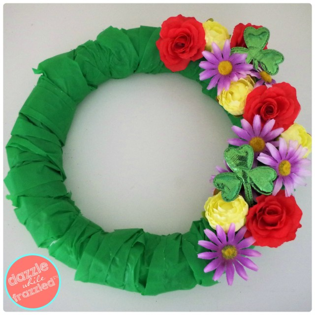 Add glitter shamrock clovers to spring floral wreath for easy DIY St. Patrick's Day home decorating.