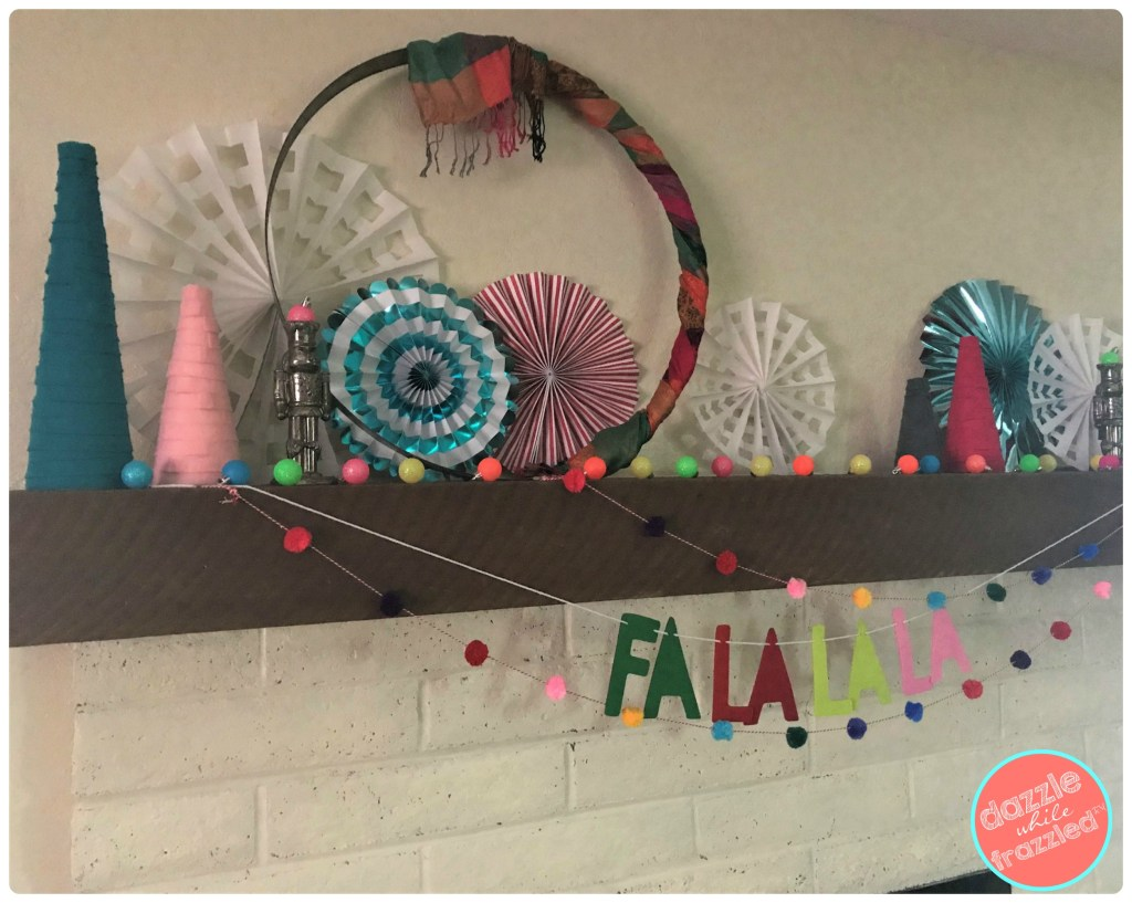 Make a modern and colorful Christmas mantel with DIY felt Christmas tabletop trees, mini Christmas tree baubles and paper fans.