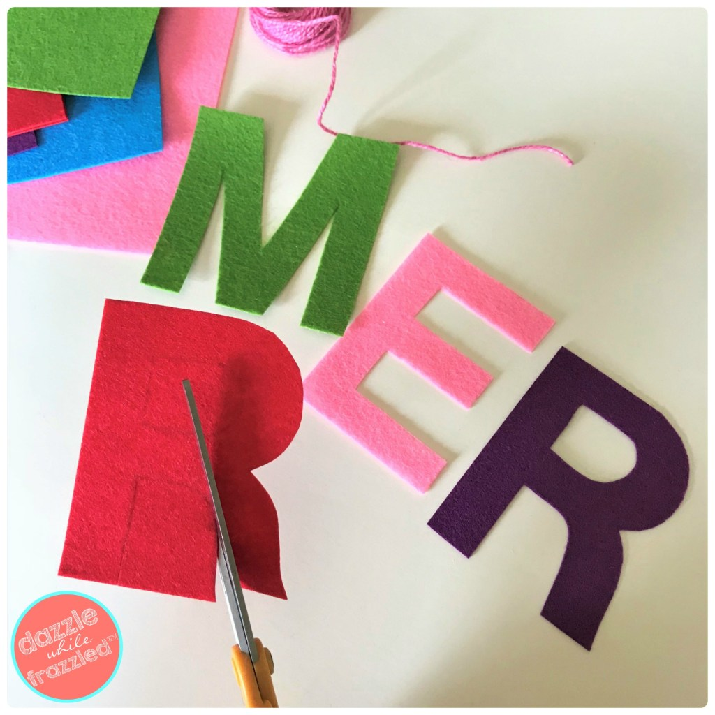 Trace large letter templates onto stiff felt craft sheets for DIY Christmas banner.