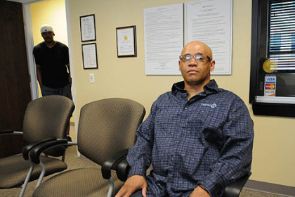 Norman Grayson, whose background is making his search for housing difficult, is a client at Adaptive Behavioral Services Inc. Behind him is Kevin M. Jordan, general manager and chief administrative officer of Adaptive Behavioral Services.
