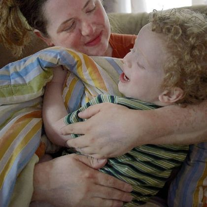 Jennifer Gallucci with her youngest son, 2-year-old Jude, who does not show any signs of autism.