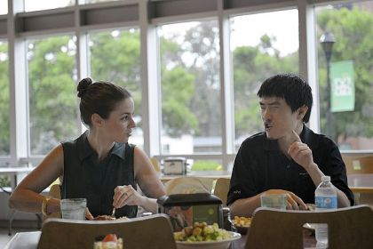 Hillary Brown, student support specialist at the College Program for Students with Autism Spectrum Disorder at Marshall University, talks with student Evan Badesch, 26, during lunch on campus.