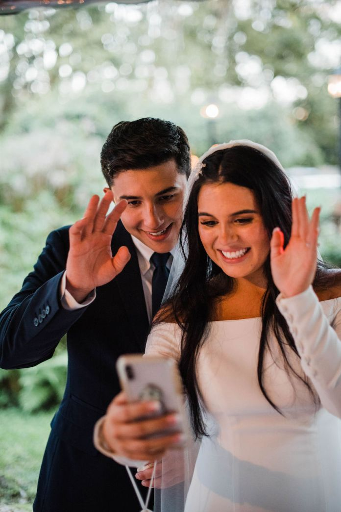 Bride and Groom on Facetime at their intimate and romantic wedding in Florida