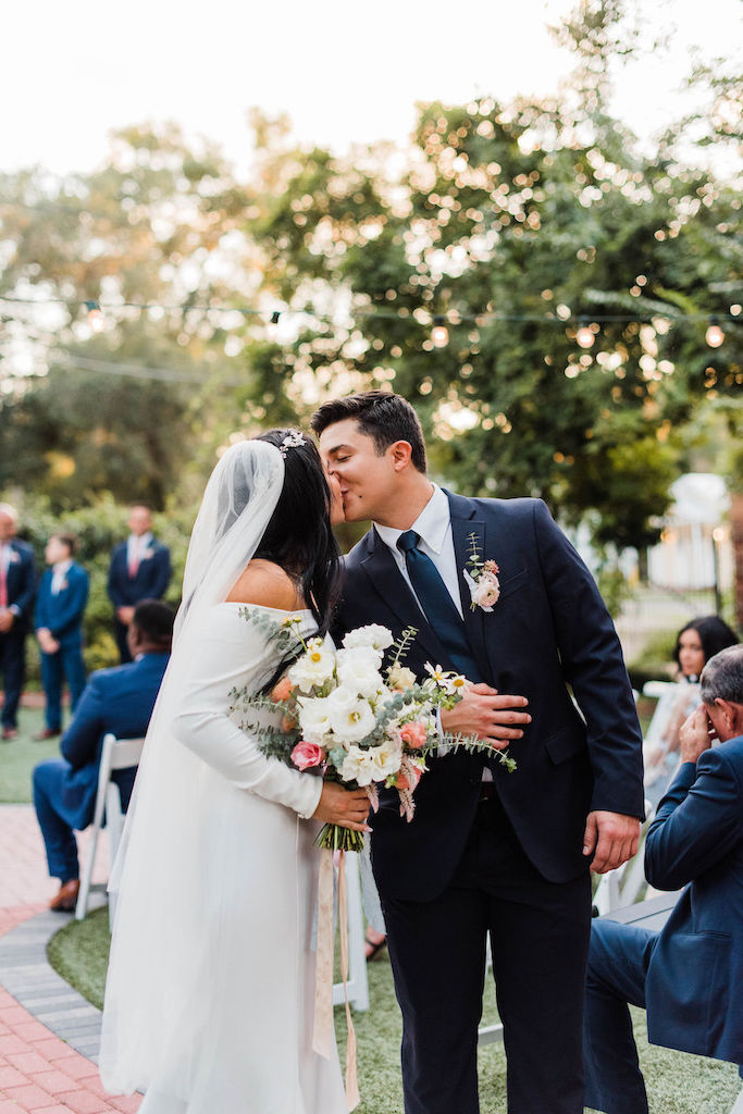 The bride and groom kiss at their intimate and romantic wedding in Florida