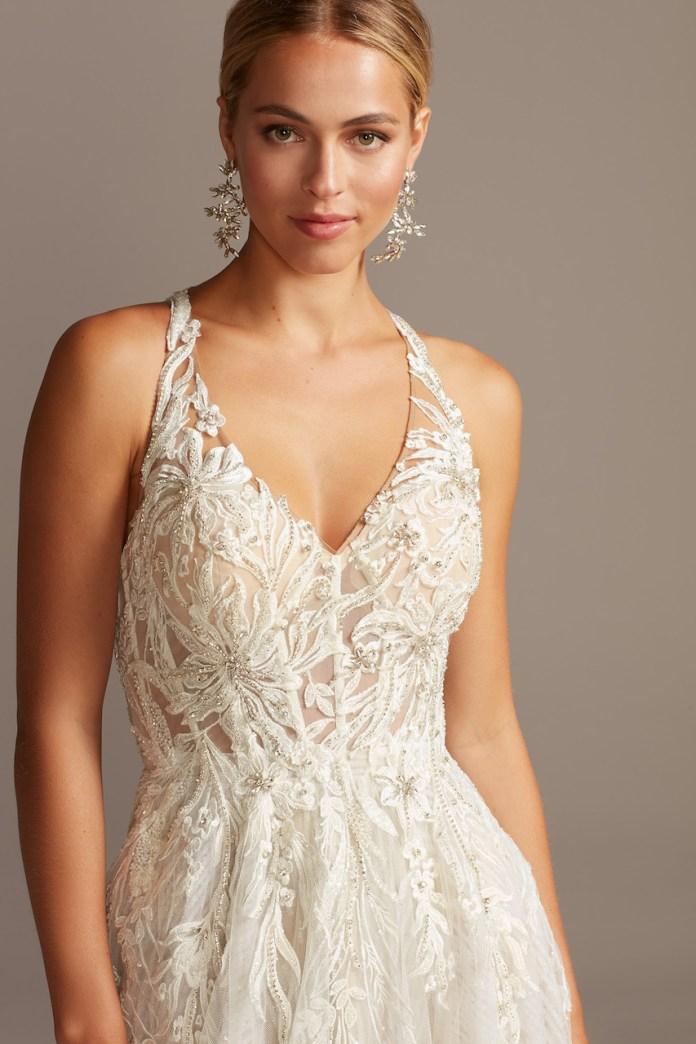 Bride wears floral applique open back tulle wedding dress