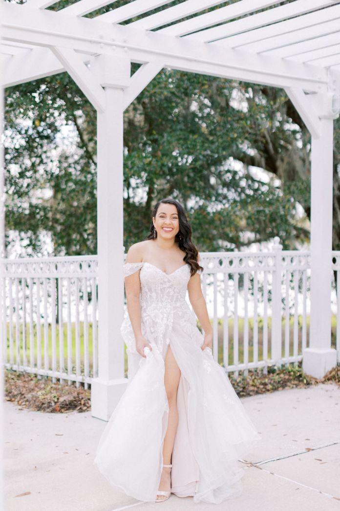 Bride shows dress