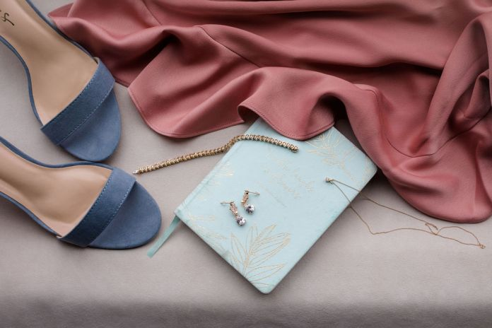 Flatlay of wedding shoes and jewelry for a dreamy spring wedding