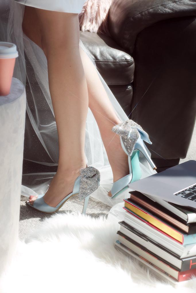 Blue stilettos with sparkling bow details for brides