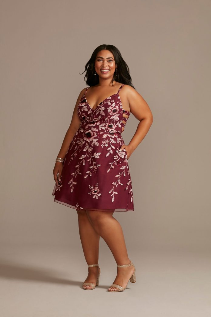 Teenager wears a floral maroon homecoming dress with side cutouts as a homecoming dress idea