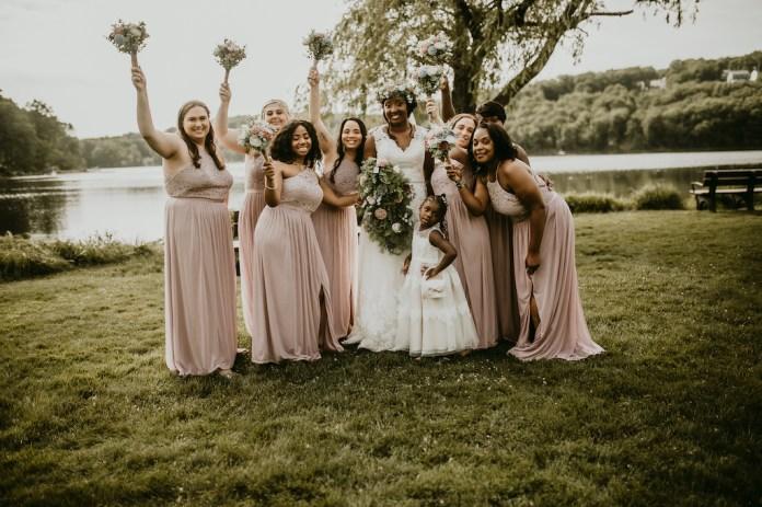 Bride and bridesmaids at a rustic outdoor wedding