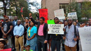 5:41pm: A peaceful protest by professionals and students began the evening, outside Bank of America headquarters. (David Boraks/WFAE)