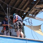 Preparing to Abseil putting on a harness at WA DB Camp in 2014
