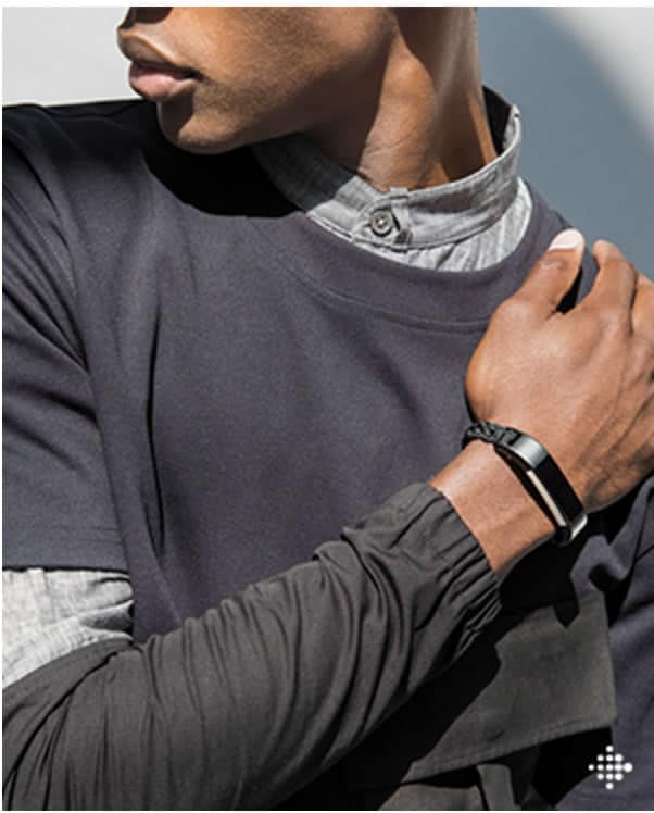 Image of a man wearing the Fitbit Alta designer collection with Public School.